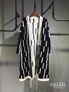 貂毛大衣外套时尚单款品牌折扣批发尾货走份-广州伊曼服饰有限责任公司