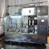 供应乳饮料屋顶型纸盒包装机高速设备沈阳北亚-沈阳北亚饮品机械有限公司